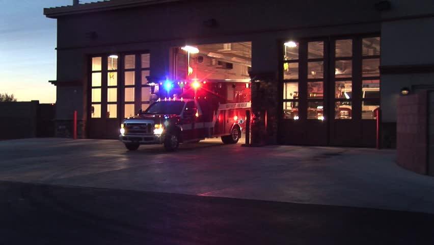 TUCSON ARIZONA US - CIRCA 2010: Ambulance And Fire Truck Leaving To Fight fire