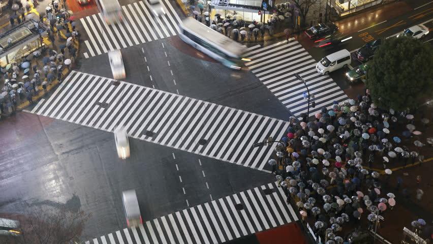 High angle shot pedestrians and traffic across Shibuya Crossing, Hachiko Crossing, Shibuya, Tokyo, Honshu, Japan | Shutterstock HD Video #2610407