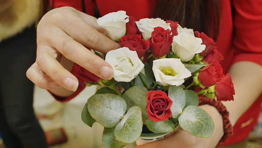 Girl collects a bouquet of roses. Preparations for the wedding, gift for a woman. hands closeup | Shutterstock HD Video #26135348
