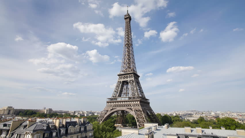 The world famous Eiffel Tower in natural light and some clouds, Paris, France | Shutterstock HD Video #2614499