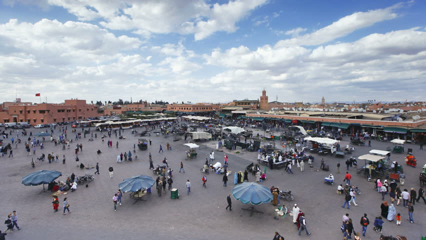 Djemaa el-Fna night market against blue and cloudy sky, Marrakech (Marrakesh), Morocco