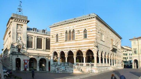 Timelapse of Udine, people walking in the street near Loggia del Lionello in the main city of Friuli-Venezia Giulia
