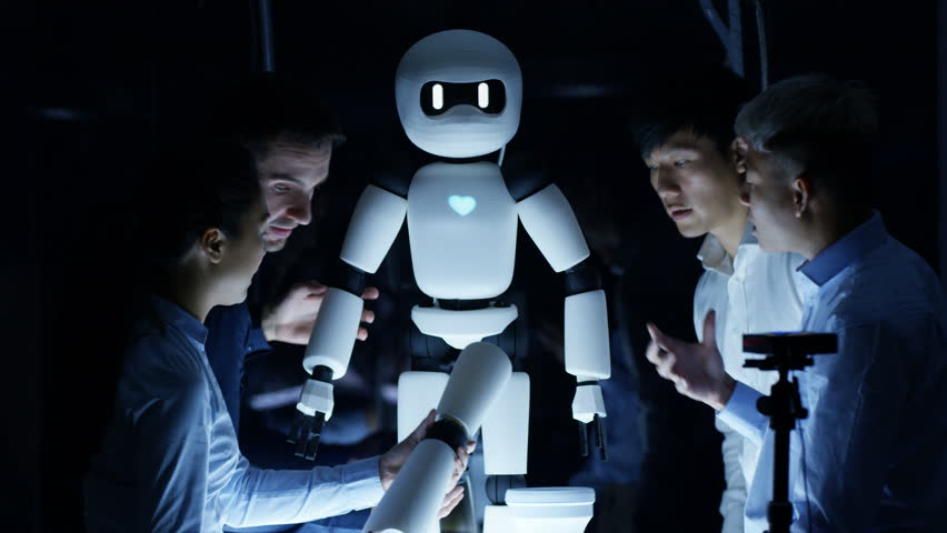 4K Electronics engineers collaborating on design of robot in dark lab | Shutterstock HD Video #26169527