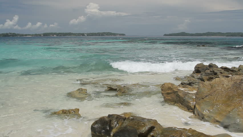 White sandy shore of a tropical island, Las Perlas archipelago, Panama, central America