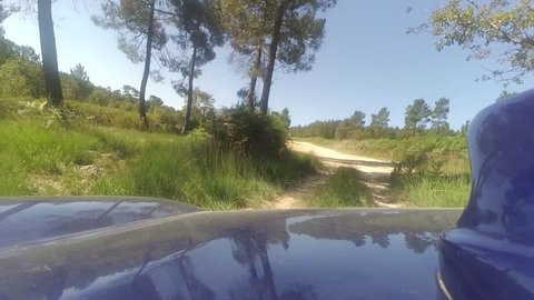 Front Gopro shot of subaru rally car racing fast around a dirt track