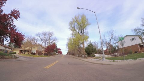 Denver, Colorado, USA-April 8, 2017.  POV point of view - Driving through Crabapple Trail in Littleton in the Spring.