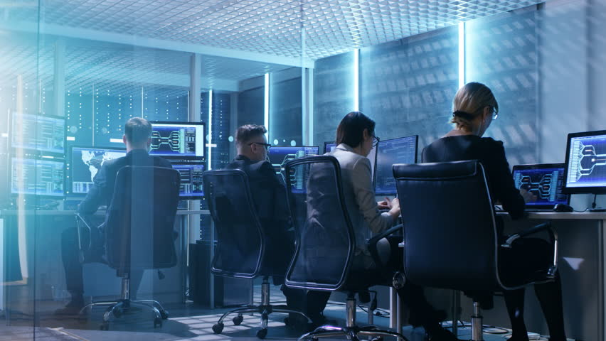 Time-Lapse Footage of Government System Control Center Full of Proffesional. They Work at Their Workstations and Interact With Each Other. Room Has Multiple Displays with Various Data Shown on Screens