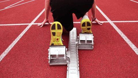 Start of sprinter in a stadium