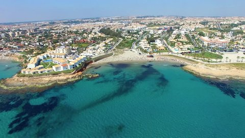 Video shot from the air, flying over the sea and the beaches of Spain on the drone