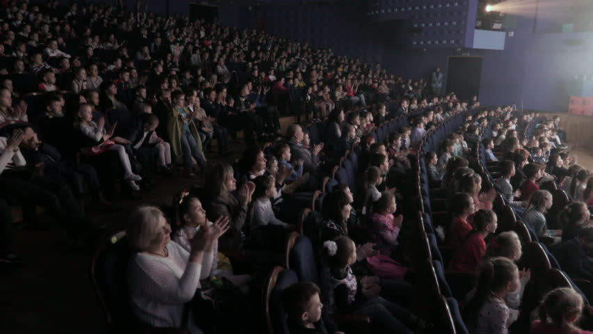 Children applauding in the auditorium during the performance. Theater for young spectators, Russia, Saratov, April 28, 2017.