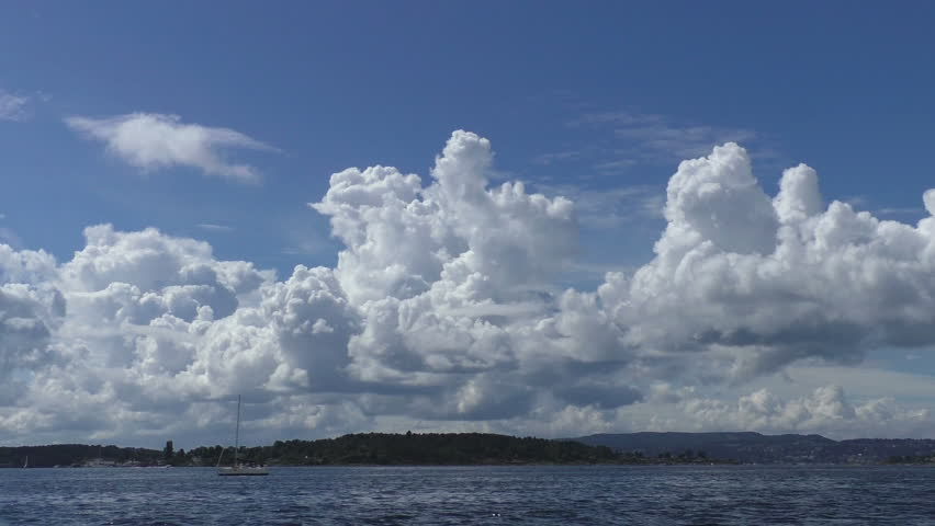 Calm and sunny summer day in Oslo. Yachts and boats are swimming at the harbor of Oslofjord.  - HD stock footage clip