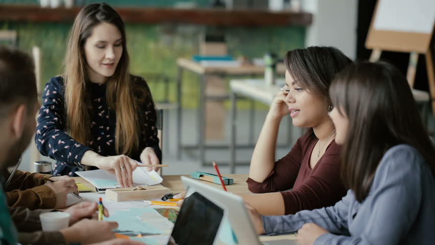 Multiethnic group of people working at modern trendy office. Business team discussing financial report, using graphs. | Shutterstock HD Video #26337770