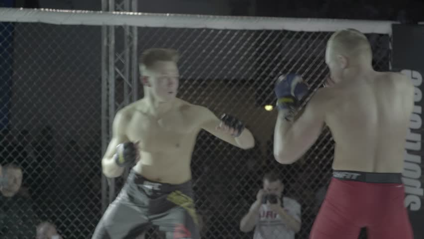 KIEV, UKRAINE - JANUARY 13, 2016. Fighters fight in a cage. Oktagon . MMA.