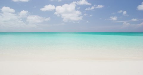 Beach background - Caribbean beach with turquoise water and white sand beach and blue sky. SLOW MOTION. RED EPIC.