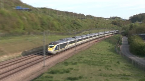 NASHENDEN, KENT, ENGLAND - APRIL 19, 2017 - New class 374 e320 Eurostar train heads along the High Speed One line in Kent with a service from the Continent.