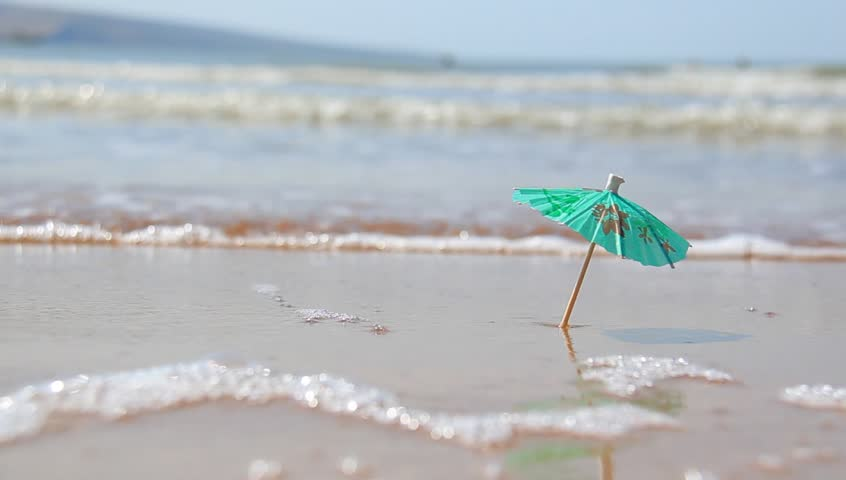Cocktail Umbrella Drink On A Beach Stock Footage Video 2649968