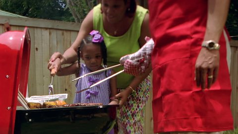 Family using barbecue grill