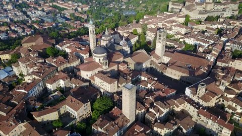 Drone aerial view of Bergamo - Old city. One of the beautiful city in Italy. Landscape on the city center, its historical buildings and towers during a wonderful blu day