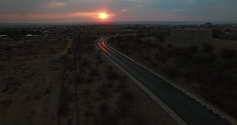 Aerial drone video with view of water reservoirs near highway of B1 main road around Windhoek with view towards industrial area in central highland Khomas Hochland of Namibia, southern Africa