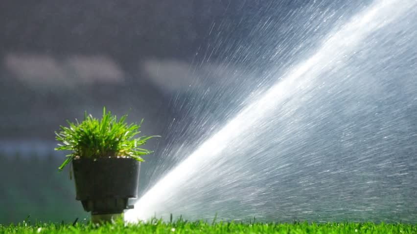Soccer or football field irrigation system of automatic watering grass. With original sound. | Shutterstock HD Video #26536397