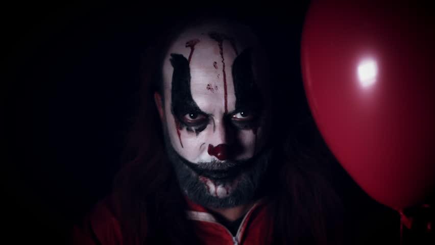 4k Halloween Horror Clown Man with Balloon | Shutterstock HD Video #26545937