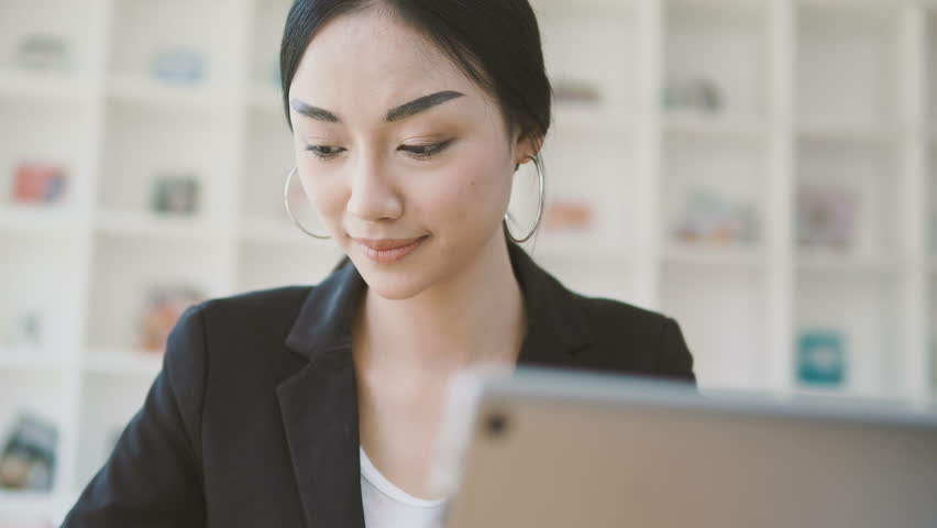 Businesswoman working on desk with laptop computer,Business woman holding smart phone,Working on desk. | Shutterstock HD Video #26546777