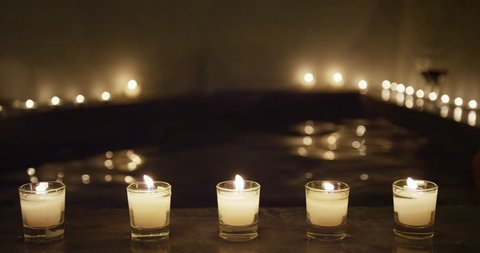 Candlelit night at jacuzzi spa pool resort in luxury private hotel room outdoor terrace. Suite for honeymoon getaway travel vacation perfect for couple relaxation. Hydrotherapy at wellness center.