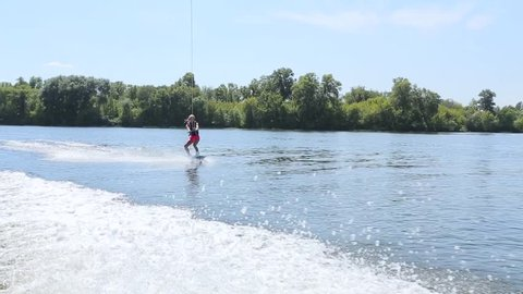 The girl is water skiing.