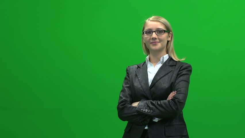 portrait of young beautiful business women standing isolated against green screen background smiling at camera