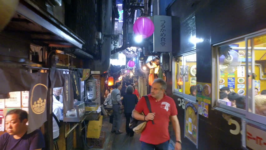 TOKYO - MAY 8, 2017: Hyper lapse POV walk along the Omoide Yokocho alley, or Yakitori alley, in Shinjuku in Tokyo Japan.