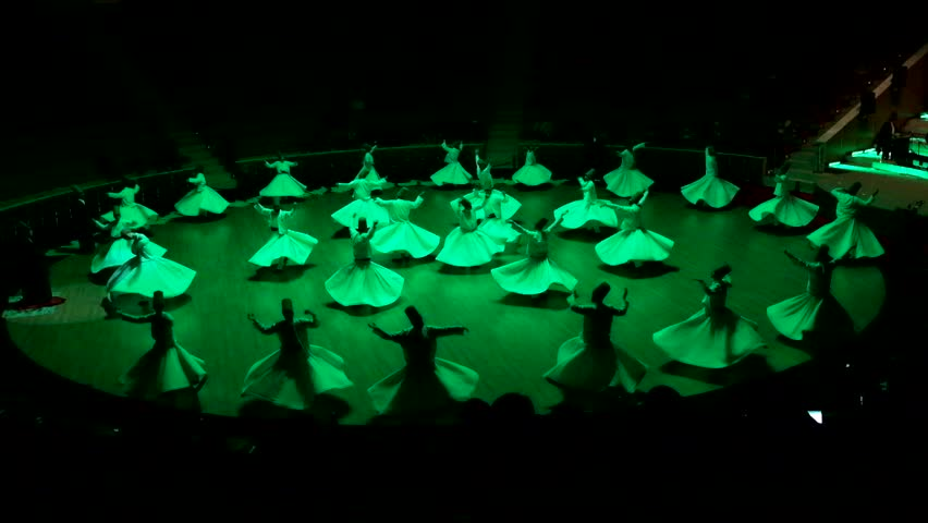 TURKEY, KONYA MARCH 18, 2016 - Sufi whirling dervish (Semazen) dances at konya. Semazen conveys God's spiritual gift to those are witnessing ritual.He spins with the music.