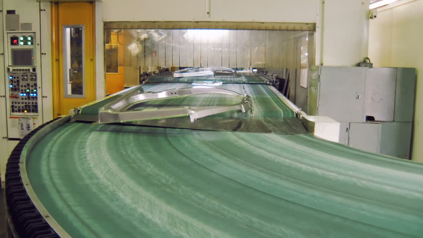 transporting tape with moving details of car body in automobile factory, making car body