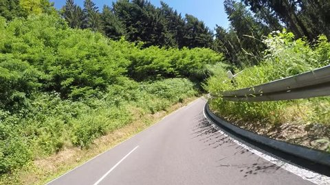 Driving lots of curves with a motorbike in the Black Forest (Germany).