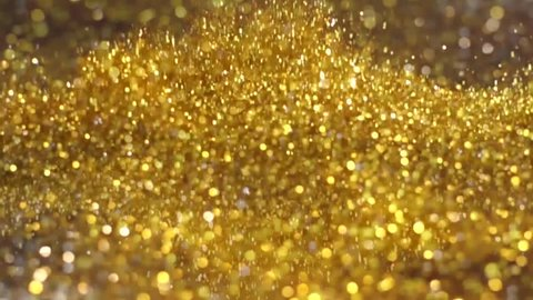 Big Explosion Golden and Silver Glitter Dust Tiny reflect light in the Air and falling, Dark black background, Selective Focus close up blurred and slow motion