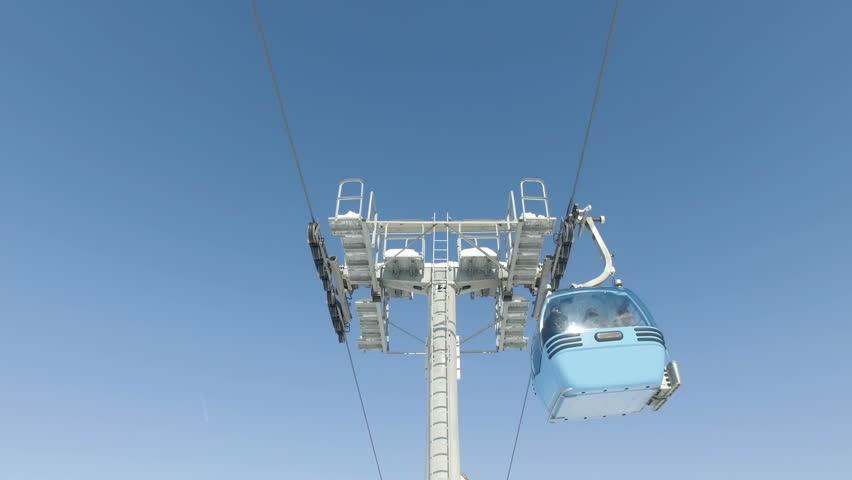 Gondola cable car ski lift against blue sky