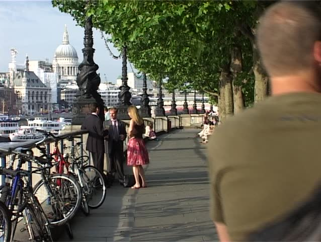 LONDON, ENGLAND - CIRCA JUNE 2007 - People walking down the embankment in Bankside towards St Paul's Cathedral.