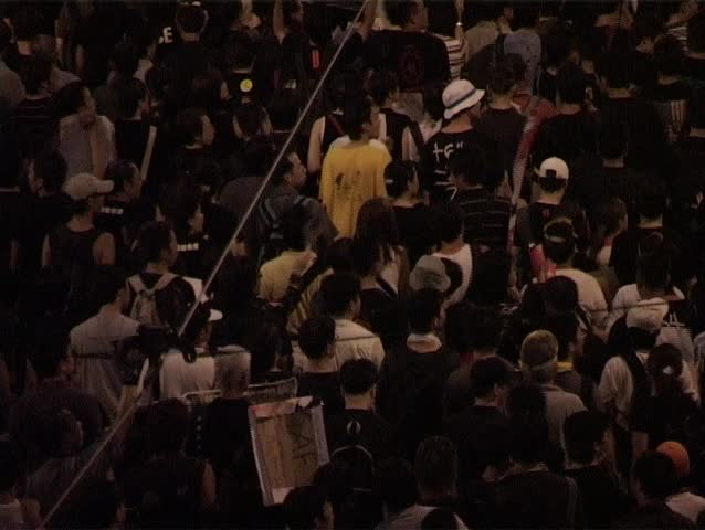 HONG KONG, CHINA - 1st JULY 2003 - This is rare footage of the now famous 2003 Protest March in Hong Kong on 1 July, 2003. This march was to oppose the anti-subversion Hong Kong Basic Law Article 23