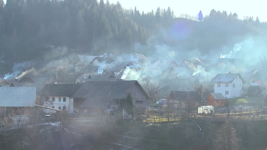LAKE BLED, SLOVENIA-CIRCA 2011-Villages in Eastern Europe pollute the environment by burning wood and coal. #2678651