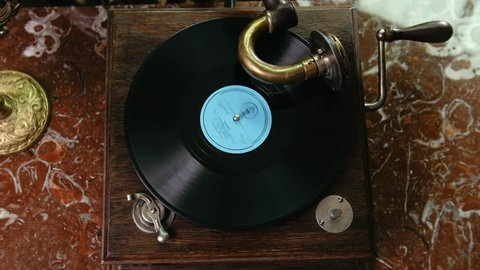 Vinyl record spinning on vintage old gramophone - top view