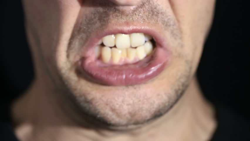Man screams into the camera on a black background. Mouth and grin close-up   Shutterstock HD Video #26803117
