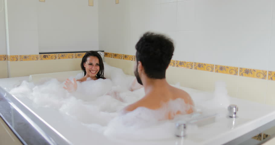 Man and woman together in bathroom