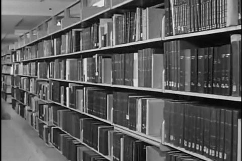 1960s: The diverse holdings of Bethesda's National Library of Medicine are shown to include everything from manuscripts to medical caricatures in 1963.
