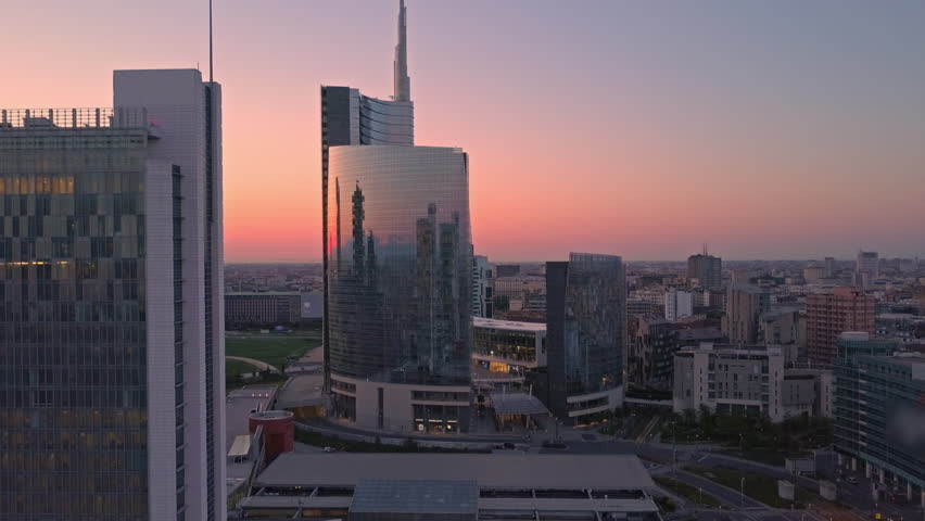 milan skyline aerial view at sunrise flying to business area