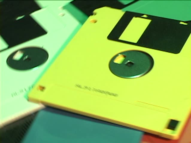 A pile of colorful floppy disks revolves in a circle.