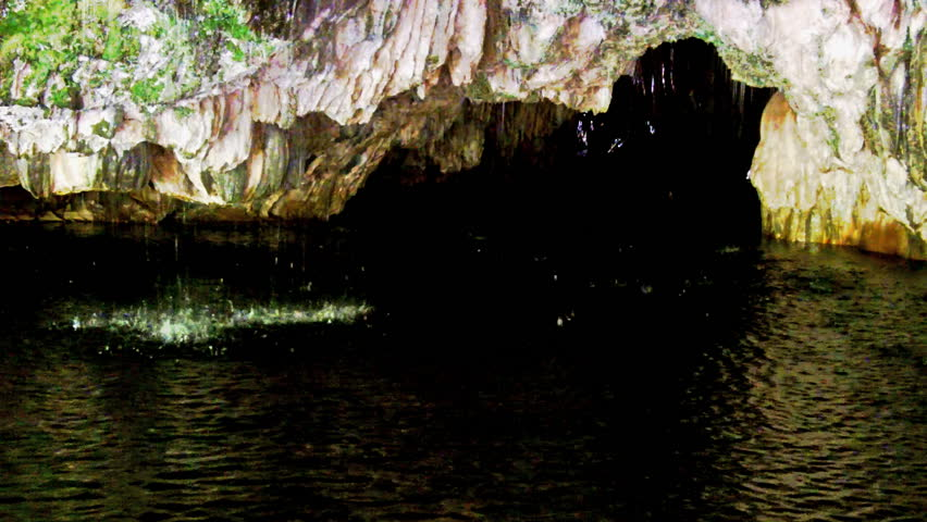 Spring water drips from the roof of a limestone underground river cave at