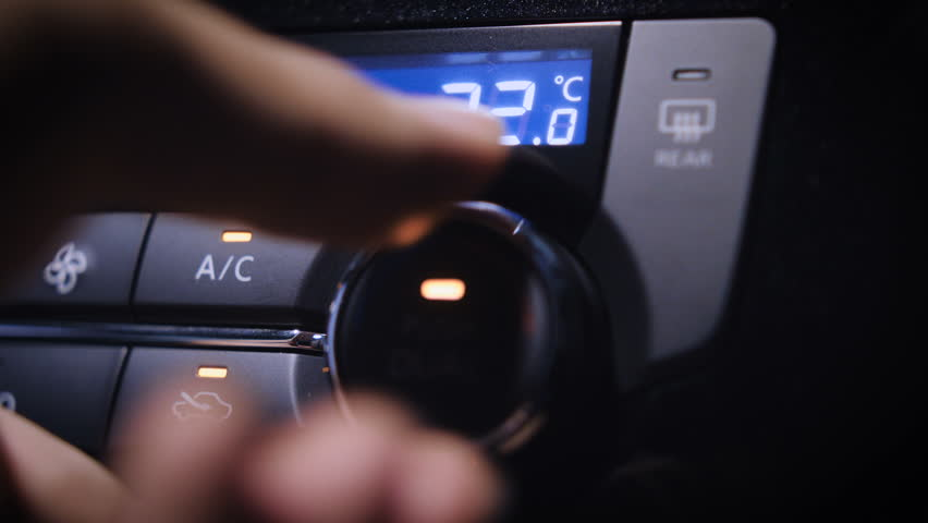 Car Air Conditioning.  Beautiful close up shot of adjusting the AC of a car. With LED display.