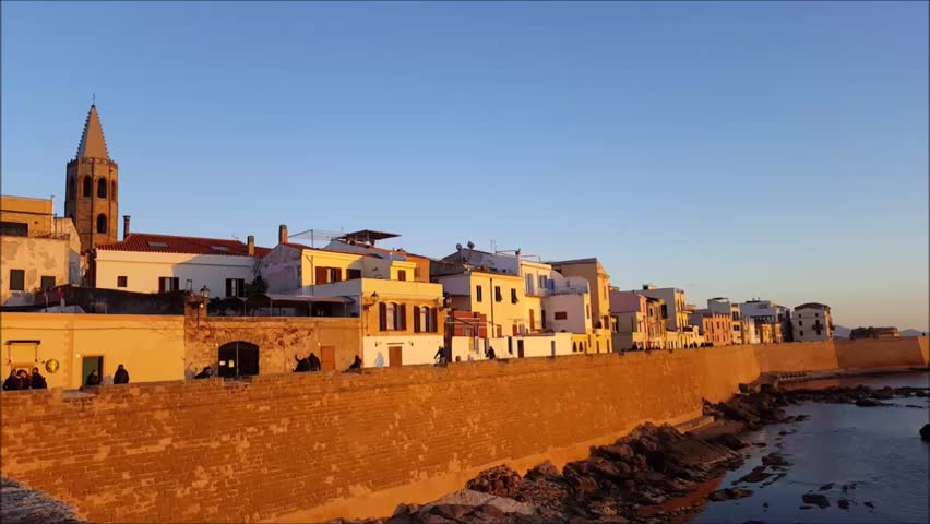 sunset on the ramparts of Alghero; old town