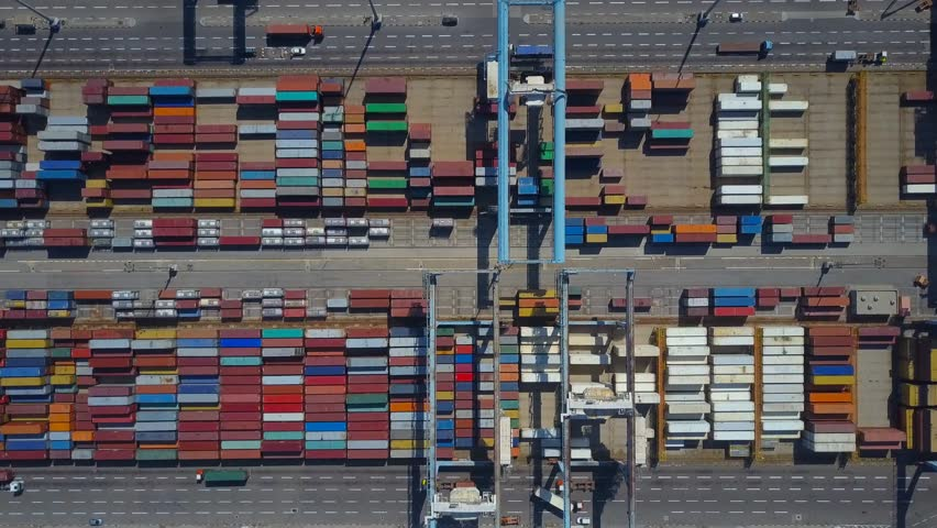 Stacks of shipping containers on a holding platform - Top down aerial view | Shutterstock HD Video #26903407
