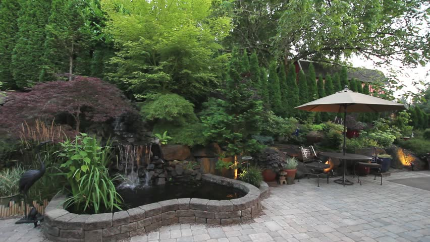 Paver Stone Garden Backyard Waterfall with Bistro Furniture and Umbrella 1080p