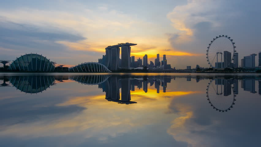 Beautiful Time lapse of Day to Night of Singapore skyline with reflection. 4K UHD. Zoom Out Camera Motion. | Shutterstock HD Video #26922211